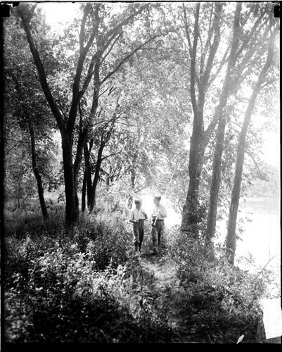 [Boys walking in the woods in Desplaines, Illinois]