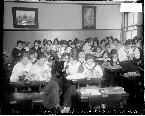 [Classroom full of girls knitting at Lake View High School, located at 4015 North Ashland Avenue in the Lakeview community area]