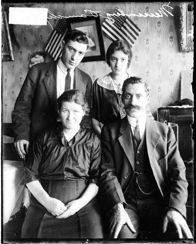[Samuel Meisenberg funeral, Meisenberg family in room with American flags]