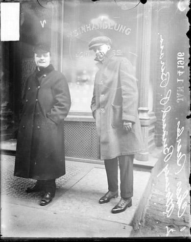 [Accused robber Charles Searle and attorney Bernard Barasa, standing in front of a wine store]