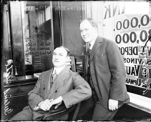 [Garland (Jack) Stahl and A. E. Olson, in a bank located at 730 E. 63rd Street]