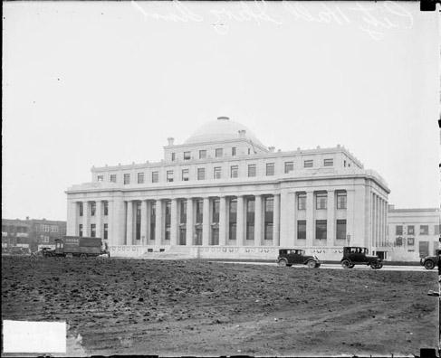 [City Hall Building in Gary, Indiana, and automobiles on road nearby]