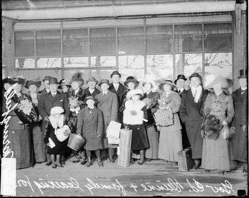 [Governor Dunne and family standing on a train platform, leaving Chicago for Springfield]
