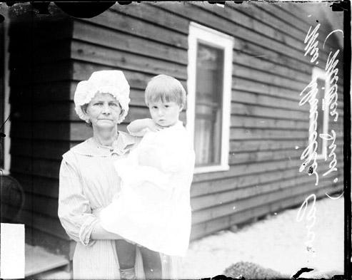[Drucilla Carr of Miller Indiana, standing in front of her squatter's shack]