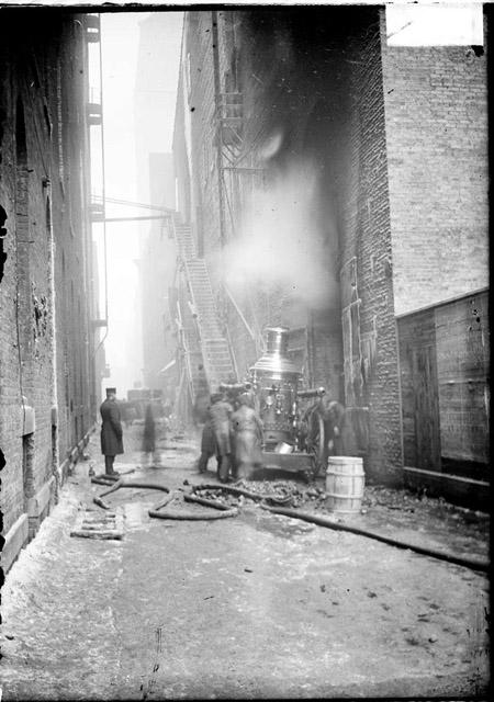 [Fire engine in an alley during the Iroquois Theater fire]