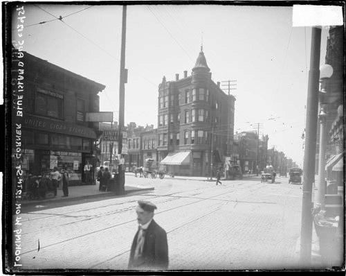 [Street scene looking west on West Roosevelt Road (formerly) Twelfth Street from Blue Island Avenue]