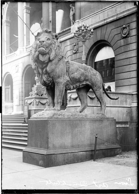 [Lion statue on the south side of the steps outside the Michigan Avenue entrance to the Art Institute of Chicago]