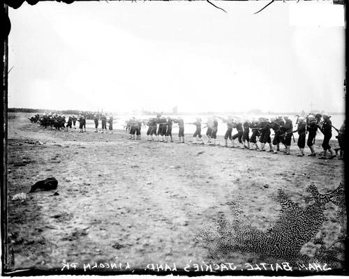 [Naval apprentices (Jackies) with rifles, lined up on the beach during a mock battle landing in Lincoln Park]
