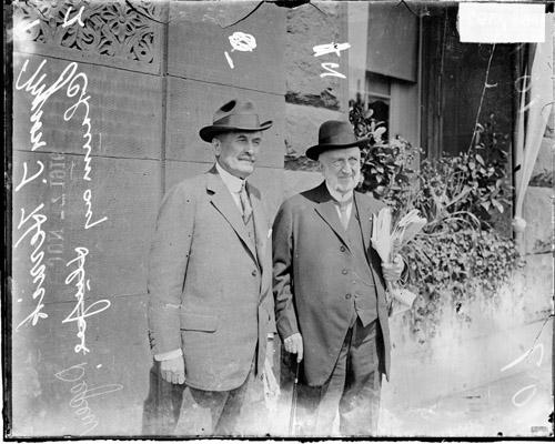 [Chauncey Depew and Myron Herrick of Ohio, standing by a window planter at the Congress Hotel]