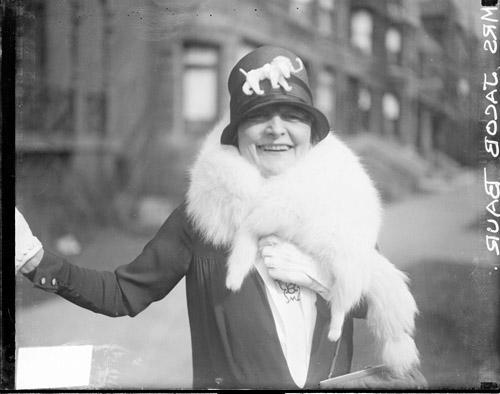 [Bertha Baur standing on a sidewalk in Chicago]