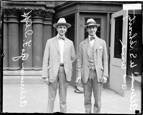 [3rd Ward aldermen U. S. Schwartz and George F. Iliff standing on a sidewalk]