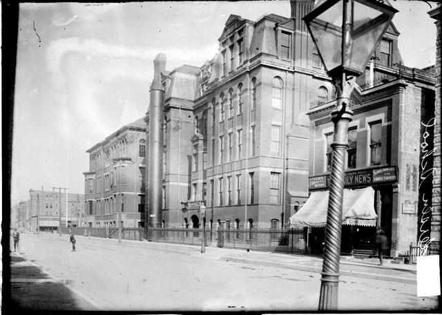 [Andersen School, viewed at an angle from across the street with a street light in the foreground]