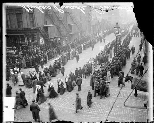 [Garment workers strike, men and women parading on West Jackson Boulevard]