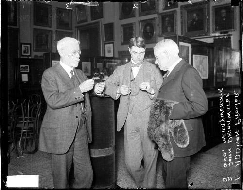 [George Merryweather, John Drinkwater, author, and Addison Procter standing in semi-circle]