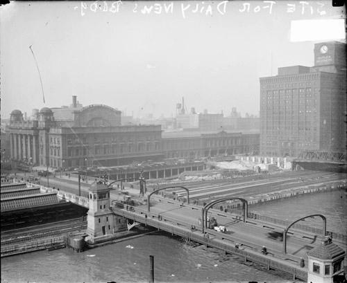 [Automobiles and pedestrians crossing the Madison Street Bridge]