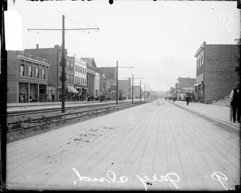 [Commercial street in Gary, Indiana, with streetcar tracks in the center]