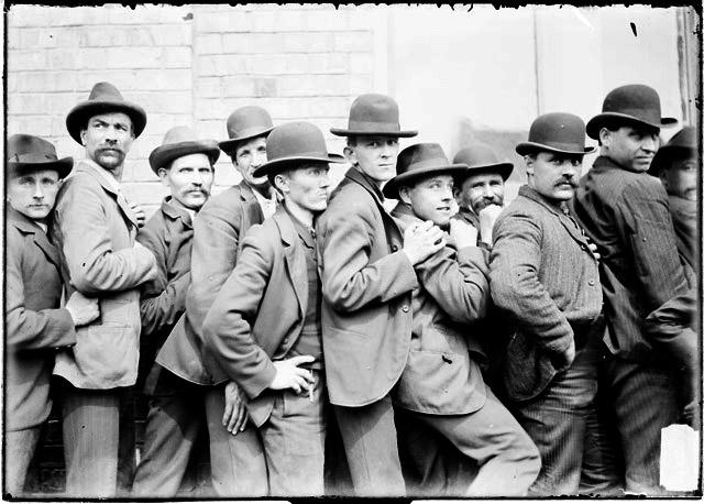 [Men standing chest to back in a tight line during a stockyards strike]