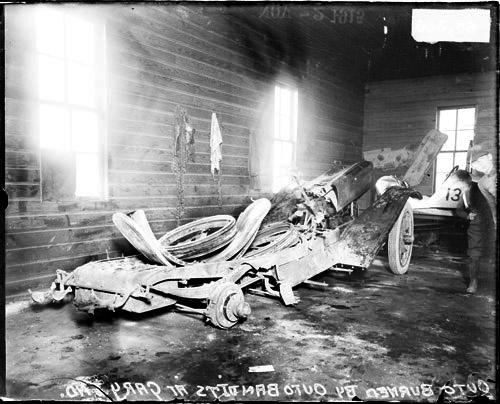 [Burned automobile in a garage in Gary, Indiana]