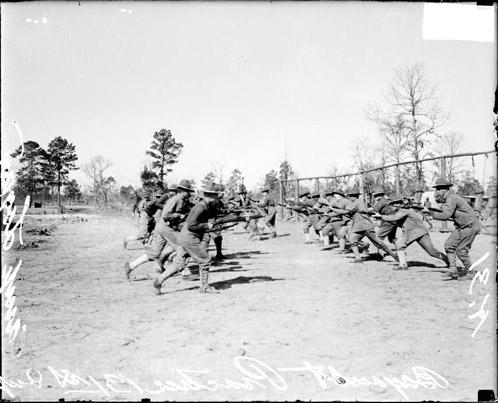 [131st Infantry charging at each other during military drills on a field at Camp Logan]