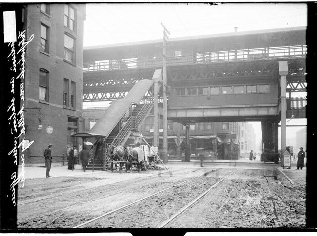 [Elevated train station at South Dorchester Avenue and East 63rd Street showing the train platform stairway from the street]