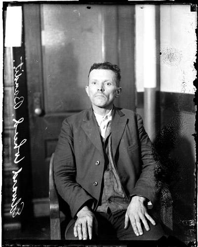 [Accused counterfeiter and bandit Edward Wheed, sitting in a room]