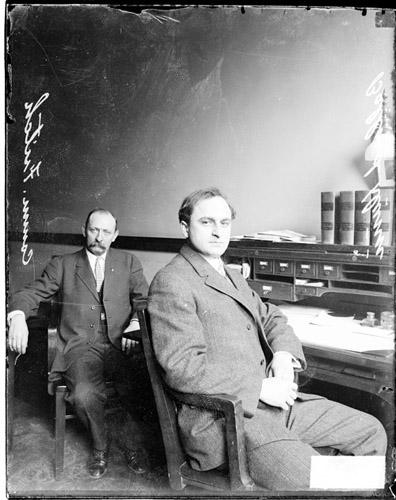 [Cook County Civil Service Commissioner Fritch and Ballard Dunne sitting by a desk]