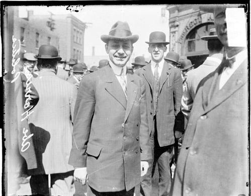[Abe Harris, politician, standing among others outdoors]