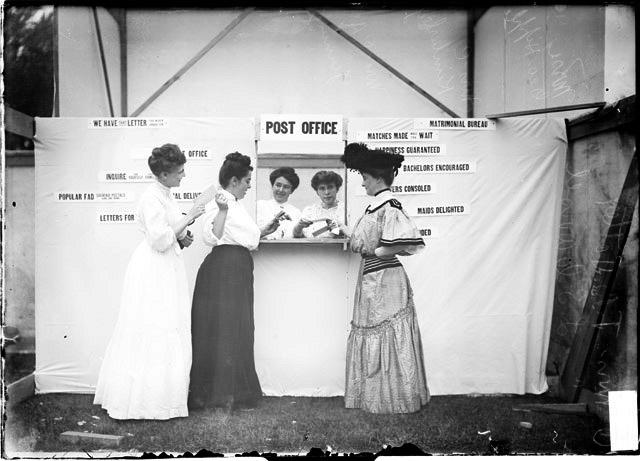 [White City amusement park, women standing at a game booth entitled Post Office]
