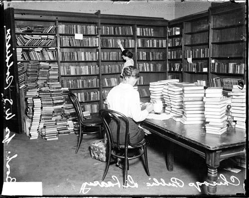 [Women working in a room at the Chicago Public Library, where they are collecting books for U.S. soldiers]