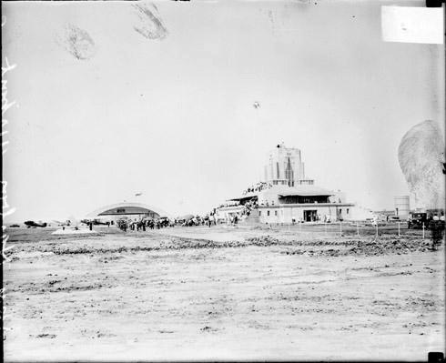 [Crowds standing in front of two buildings at Sky Harbor Airport in Glencoe, Illinois]
