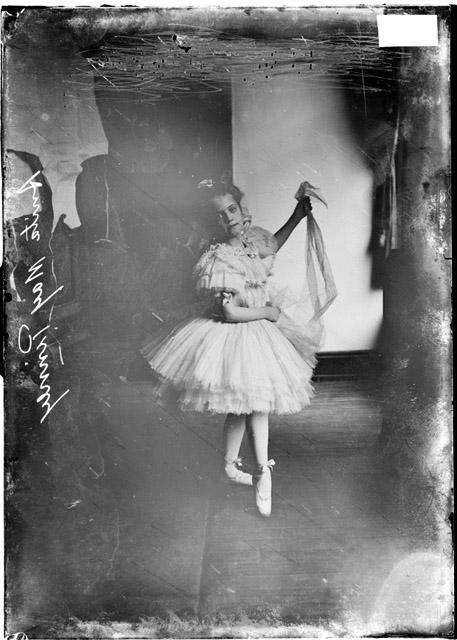 [Anita May Pinney, a young girl, dressed in a ballet dancer's costume, posed in a dance position]