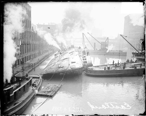 [Eastland disaster, steamer lying on its port side in the Chicago River]
