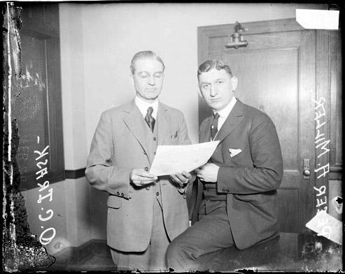 [122nd artillery, O. C. Trask and Lieutenant Peter A. Miller standing in room]