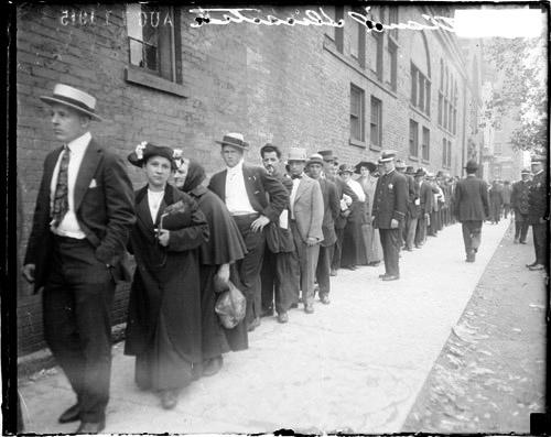 [Eastland disaster, people lined up outside the temporary morgue at the Second Regiment Armory]