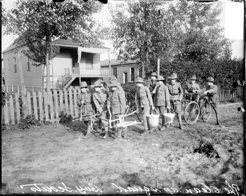 [Clean Up Day, Near South Side, Boy Scouts walking and riding bicycles in an alley]
