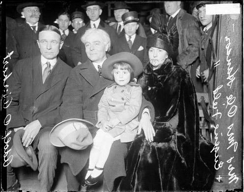 [Adolph O. Aberhart, Seattle Mayor Ole Hans, wife and daughter, Eugenie Field Hanson on bench]