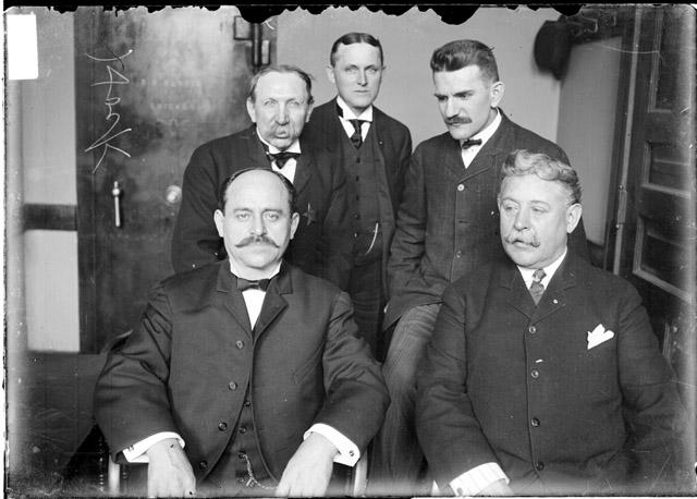 [Johann Hoch, accused bigamist and murderer, (on the left in the middle) and four unidentified men]