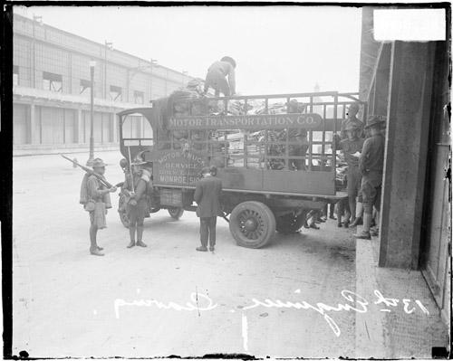 [13th Army Engineers packing gear into the back of a truck]