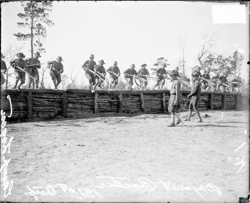 [131st Infantry near wall at Camp Logan]