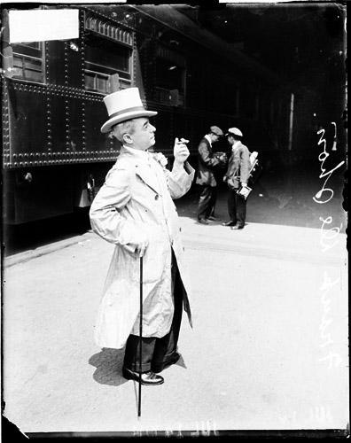 [Actor, Frank DeShon, standing near a train car]
