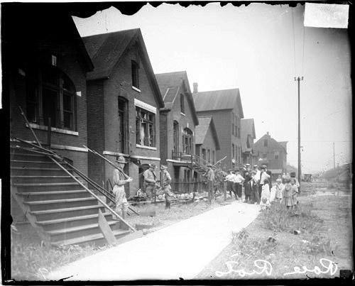 [Chicago race riot, soldiers with rifles standing guard at vandalized house]