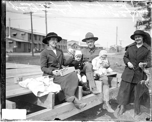 [John Ogniewski, of 311th Engineers, Company B, sitting with his wife, two children and an unidentified family member at Camp Grant]
