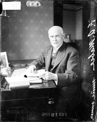[Mr. F. A. Mabee, mine owner, sitting at desk]