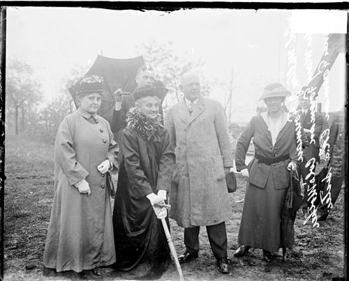 [Colonel Milton Freeman, standing in a field at Camp Lincoln, with his mother, Mary, and sister, Agnes]