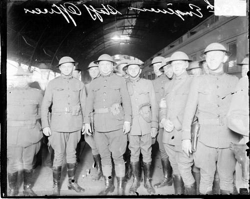 [13th Engineers Division staff officers standing next to train in station]