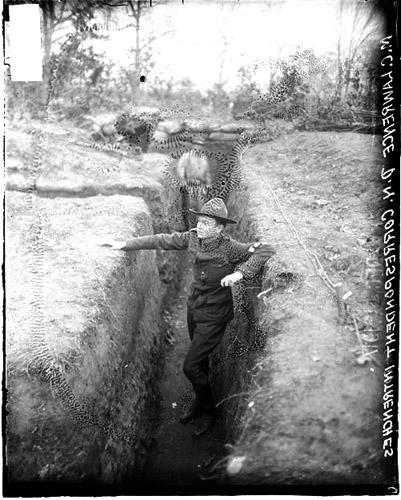[Chicago Daily News war correspondent, Millard Lawrence, standing in a trench at a camp, probably at Camp Grant in Rockford]