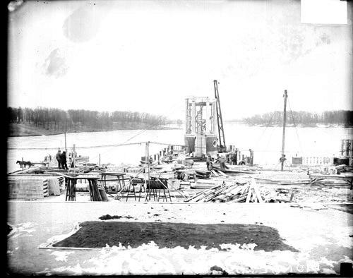 [Construction taking place along the shore of a body of water in Mundelein, Illinois]