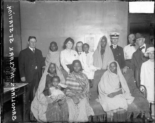[Group of Somali women and girls at the Clark Street police station]