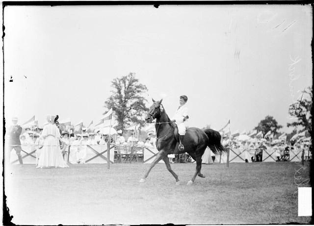 [Alex McKinlock riding a horse at the Onwentsia Horse Show]