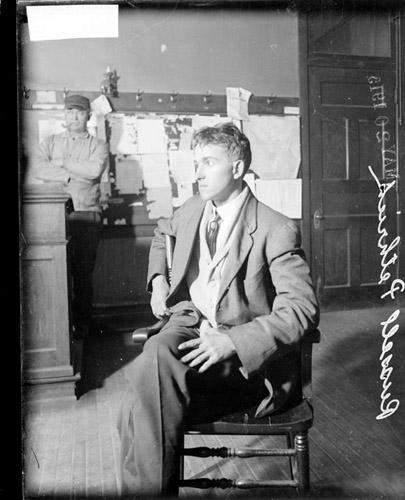 [Coppersmith murder case, Russell Pethrick, accused murderer, sitting in an Englewood police station, with legs crossed]